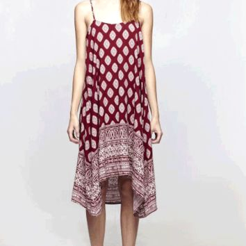 Featuring scoop neckline with twist spaghetti straps, featuring tribal(pattern circle, floral, leaf) print throughout, relaxing fit and finish with asymmetrical bottom hem. Great transitional piece to take it to fall season, pair with leggings, boots and c