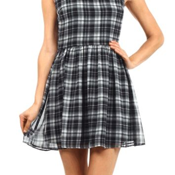 Featuring semi-sheer chiffon fabrication, black/white plaid print throughout, sleeveless, contrast with white color Peter Pan Collar with peek-a-boo keyhole back with single button closure, pleated flare skirt, hidden side zipper closure, and finished with