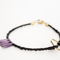 Purple Daggers & Brass Diamond Cut-Out Seeds Bracelet