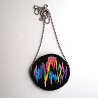 Multicolored embroidered pendant necklace with funky abstract design in neon and black space glam