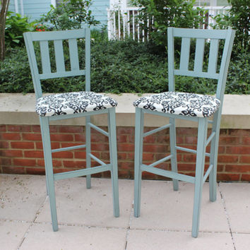 Pair of shabby chic bar stools, painted in Annie Sloan Duck Egg Blue chalk paint, distressed, and upholstered in damask patterned fabric