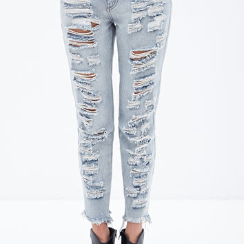 Mid Rise- Distressed Skinny Jeans