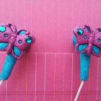 Fuchsia and Turquoise Gliitter Butterfly earuds by HoneyBadgerBuds