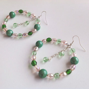 Hoop earrings with crystals in pinks and greens, dangle center