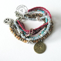 Bohemian hippie friendship gypsy bracelet of turquoise, pink and grey with multiple rows of beads