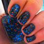 "Nail polish - ""When planets collide"" bright blue glitter in a black jelly base"