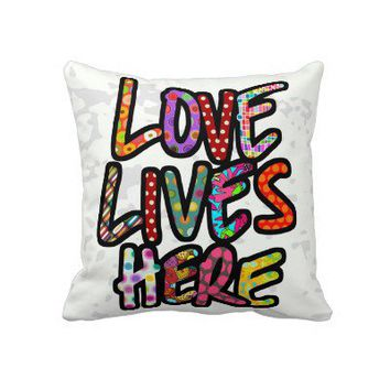 LOVE LIVES HERE light Throw Pillows from Zazzle.com