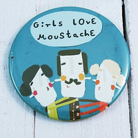 A magnet with funny illustration - Girls love moustache.