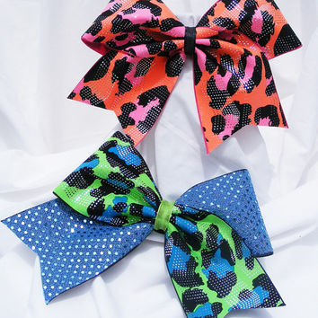 Cheer bow -  Neon blue or pink camo print with sequins. cheerleader bow - dance bow -cheerleading bow