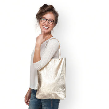 Gold leather tote bag by Leah Lerner