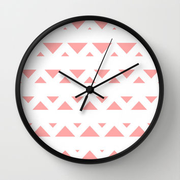 Coral Pink Tribal Triangles Wall Clock by BeautifulHomes | Society6