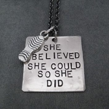 SHE BELIEVED SHE COULD SO SHE DID with Sterling Silver Shoe Print Charm Necklace - Nickel pendant with Sterling Silver Shoe Print Charm priced with Gunmetal chain