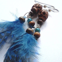 Hand carved wooden skull and blue feather earrings