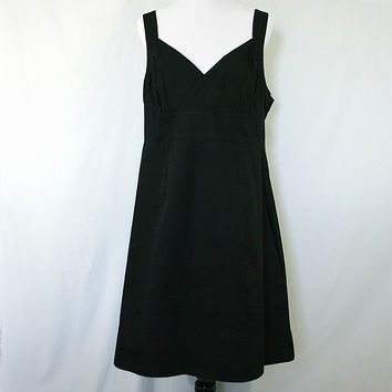 Black sleeveless v-neck empire waist dress