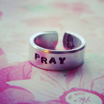 Pray  stamped inside aluminum cuff ring