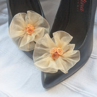Flower shoe clips from yellow organza ribbon with golden rose detail