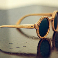 Handcrafted wood sunglasses with laser engraved texture, Made in Italy.