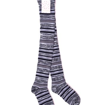 Soft and cozy knit tall sock with ribbed trims.