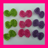 9 small green, purple and cerise crochet bows, appliques and embellishments