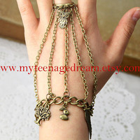 Steampunk style, ring and bracelets created with chain, owl, wing, tree, and rabbit pendants