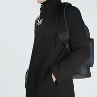 Coat with knit detailing