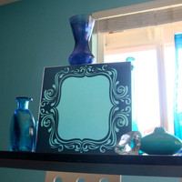 Gray swirl framed mirror