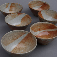 SET of six small stoneware bowls with Shino glaze by chaurie