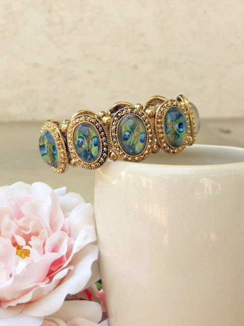 Encased Peacock Bracelet [2633] - $23.00 : Vintage Inspired Clothing & Affordable Summer Dresses, deloom | Modern. Vintage. Crafted.