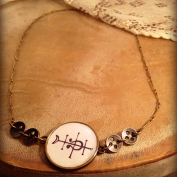 Elegant handmade Necklace. Resin Bezel Cabochon Necklace. Old tribal buttons and alchemy symbol Torrefaction