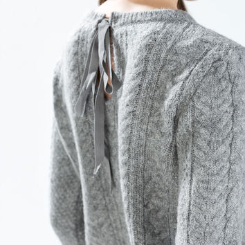 Cable knit sweater with back tie