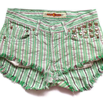 Green cut off shorts M