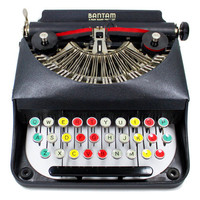Antique Bantam Typewriter with Color Glass Keys by Remington in the Original Case