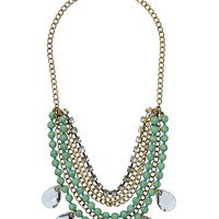 Multi row chain and crystal statement necklace