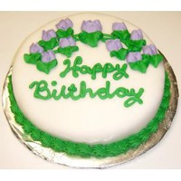 Scott`s Cakes Single Layer Decorated Cake Topped with Rolled Fondant 8` Rd. Lemon Cake with Purple Trim and Pink Flowers