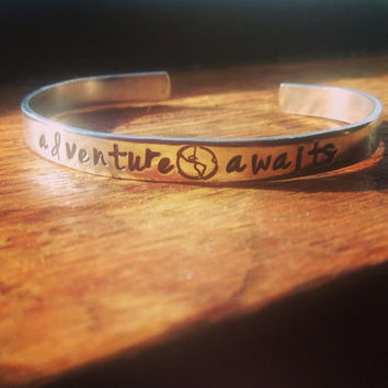 Adventure awaits , hand stamped inside  1/4 wide aluminum bracelet, wanderer, adventurous