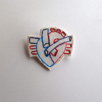 Anatomical embroidered heart brooch with reds and blue on cream muslin with cream felt backing