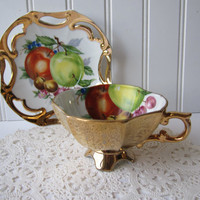 Vintage Gold and Fruit Footed Teacup & Saucer
