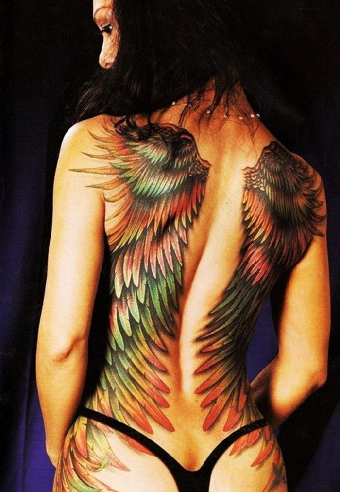 Female nude tattoo full back wing tattoos from for Nude women tattoo