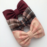 Limited edition large hair bows from Seaside Sparrow.  Plaid flannel, burgundy, and pink plaid flannel large bows