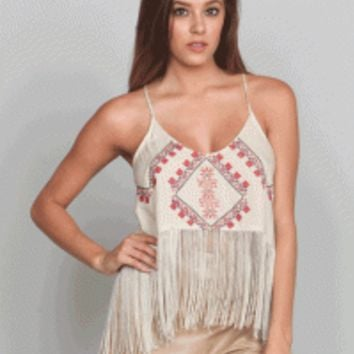 This top features embroidery at front, cascading tassel fringes around the asymmetrical bottom hemline, round neckline, sleeveless, adjustable spaghetti shoulder straps.