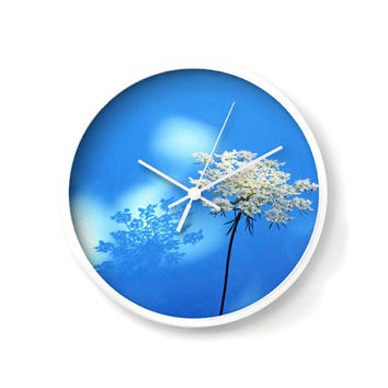 Wall Clock with Queen Ann's Lace flower, white on blue