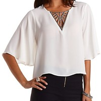 Beaded Cut-Out Angel Sleeve Top by Charlotte Russe - Ivory