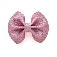 Pink glitter hair bow on barrette clip.