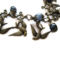Jewelery Steampunk bird Charm bracelet Antique Gold Swallow Blue Glass pearls