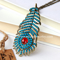 vintage beautiful peacock  feathers necklace, made with blue beads and red crystal