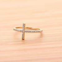 SIDEWAYS CROSS ring with swarovski crystal in gold  by bythecoco on Zibbet