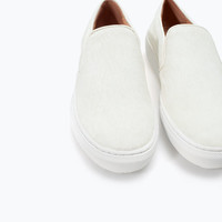 Leather and fur slip-ons