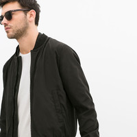 Jacket with faux leather collar