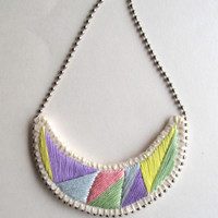 Pastel necklace geometric hand embroidered crescent shaped on cream felt with silver ball chain