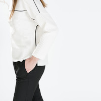 Faux leather piped top